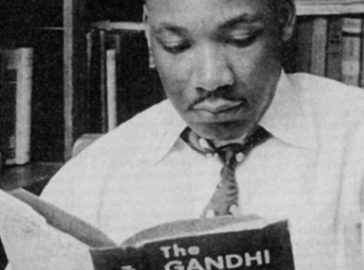 King reading the Gandhi Reader, © Moneta Sleet