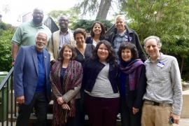 Participants in the conference pose with Dr. Clayborne Carson outside the venue. Bottom row, left to right: Clayborne Carson, Maria Varela, Greisa Martinez, Mary King, Todd Davies Upper row, left to right: Charles Taylor, Austin Belali, Maria Stephan, Jamila Raqib, David Hartsough.