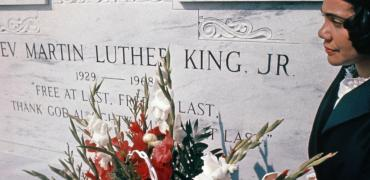 Coretta Scott King places flowers at King's grave. Photo by Bob Fitch, courtesy of the Bob Fitch Photography Archive, © Stanford University Libraries.
