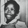 Ruby Bridges, age six, with a wide smile on her face.